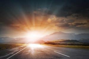 Sunrise above road